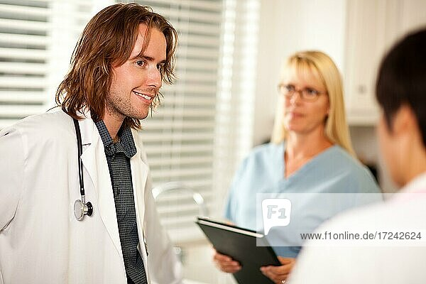 Doctors and nurses having A casual conversation in the office