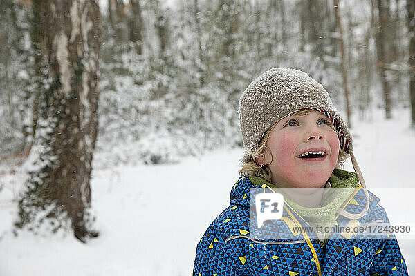 Boy looking up during winter