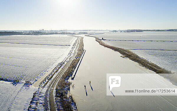 Nederland  Friesland  Broek  Aerial view of frozen canal and snow covered fields