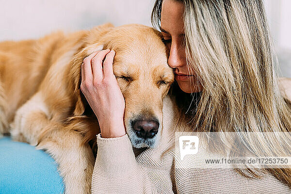Italy  Young woman with dog at home