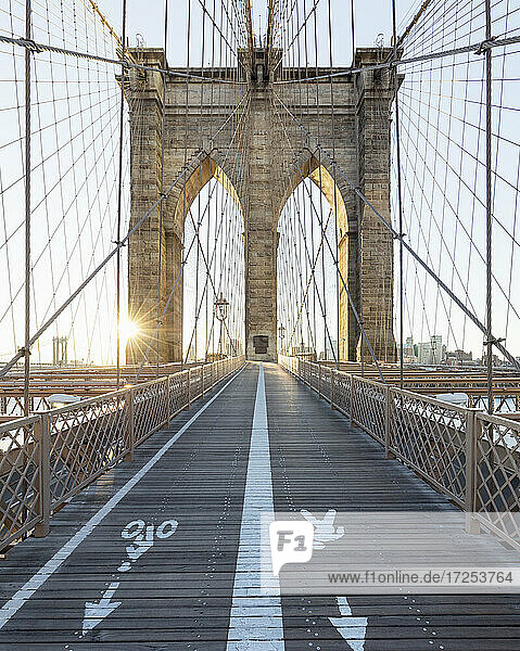 USA  NY  New York City  Brooklyn Bridge footpath and bike lane at sunset
