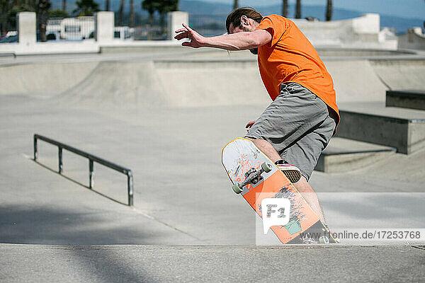 USA  California  Ventura  Man skateboarding in skate park
