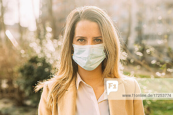 Italy  Portrait of young woman wearing protective face mask