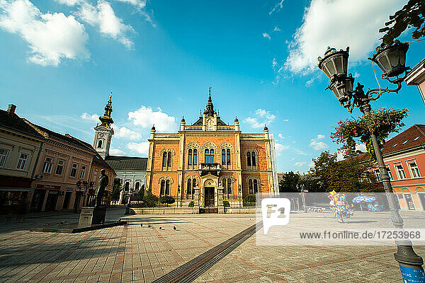 Low angle view of Bishop's Palace  Zmaj statue and Orthodox Cathedral in city