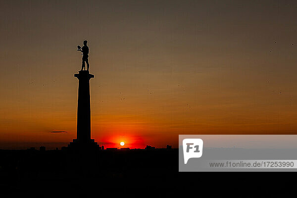 Silhouette of Belgrade Fortress with The Victor monument during sunset
