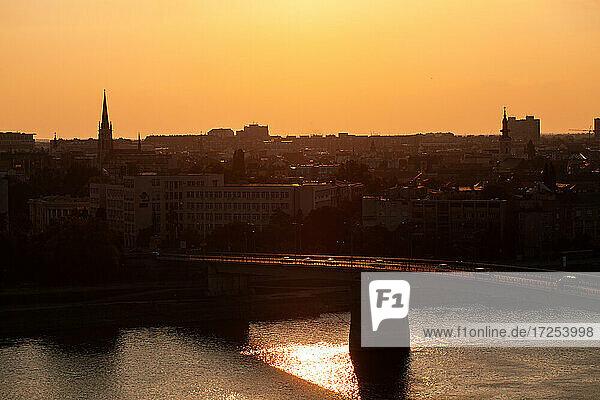 View of Varadin Bridge over Danube river and city during sunrise  Novi Sad city