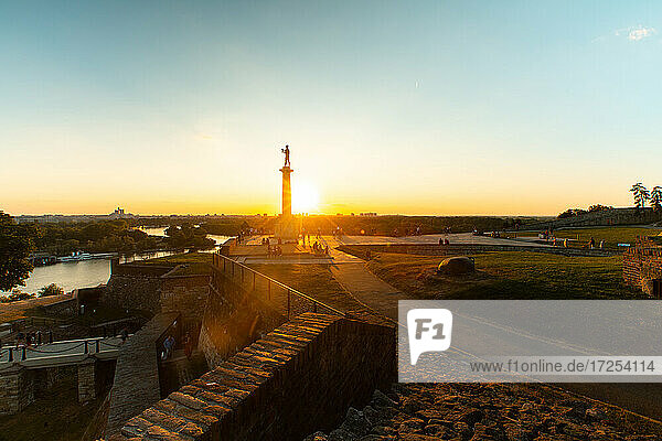 View of Belgrade Fortress with The Victor monument during sunrise