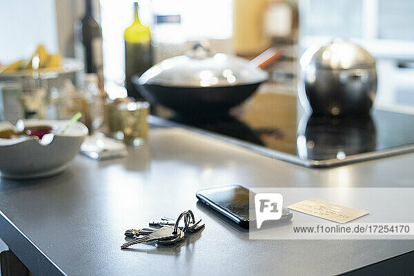 Close-up of smartphone  keys and credit card on kitchen worktop