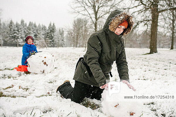 Canada  Ontario  Mother and son playing in snow