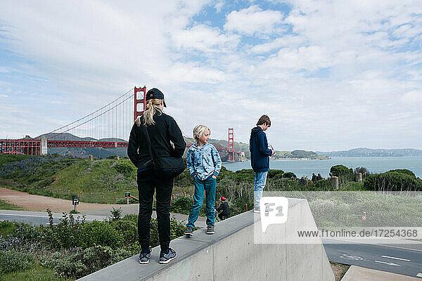 USA  California  San Francisco  Children standing on wall