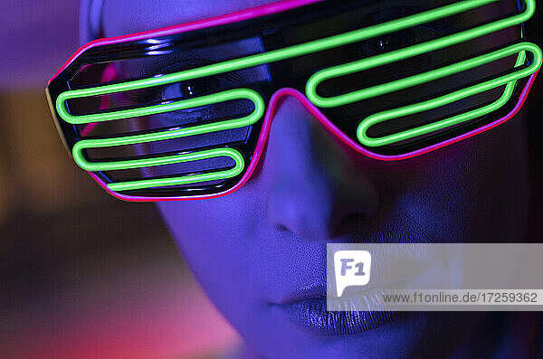 Close up portrait woman in modern neon glasses