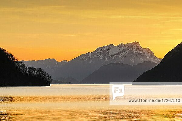 Lake with mountains in the background  view from Brunnen over the Vierwaldstättersee at sunset with Pilatus in the background