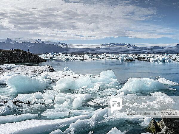Icebergs floating in Jokulsarlon lake situated at head of Breidamerkurjokull glacier