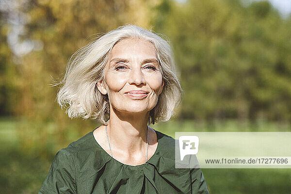 Beautiful mature woman at park