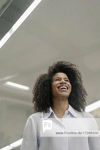 Happy businesswoman looking away in industry