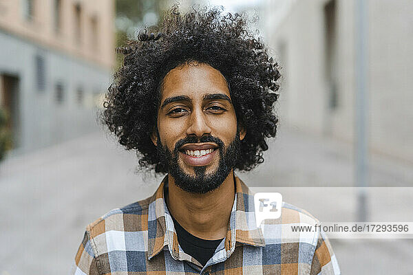 Young man with afro hairstyle smiling
