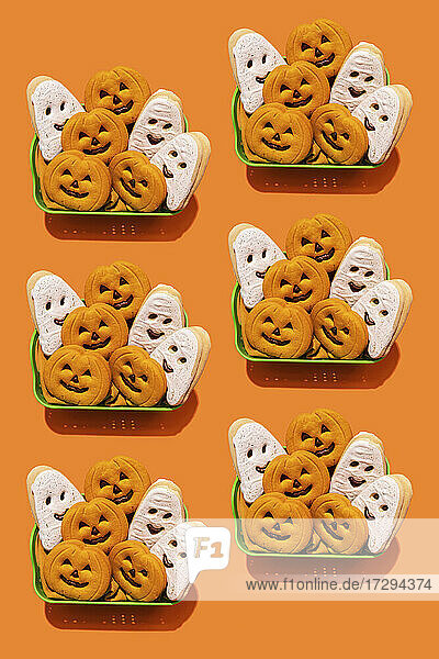 Pattern of baskets filled with Halloween themed cookies