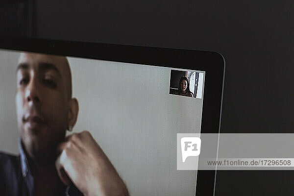 Businessman on video call with female professional at home