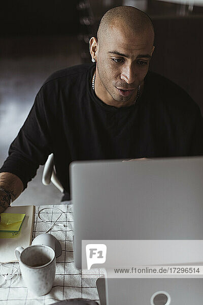 Male entrepreneur working on laptop from home