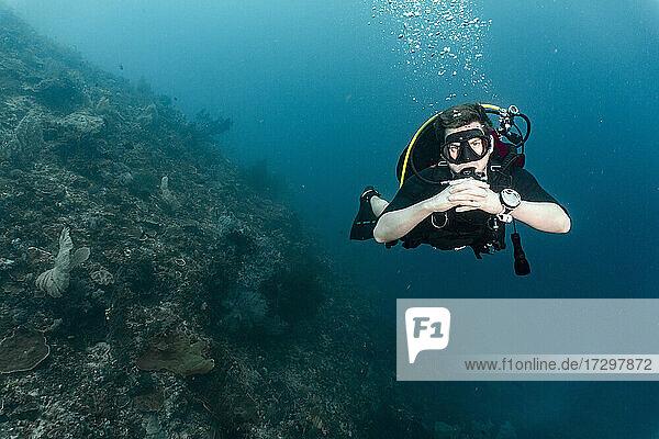 diver floating and exploring the ocean at Raja Ampat