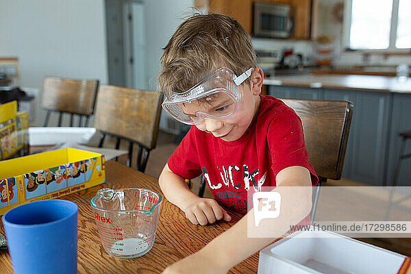 Child making funny face while conducting science experiment