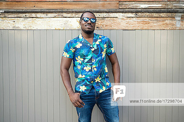A young black man in street. Outdoor portrait of traveler. Portrait
