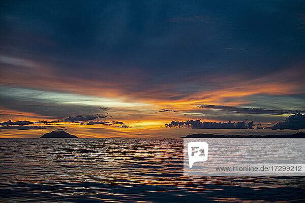 sunset on the ocean close to Raja Ampat