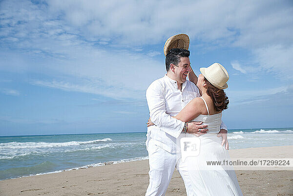 Couple in love  Hispanic man with Latin woman  walking on the beach.