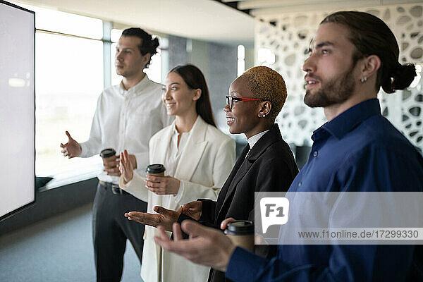 Positive diverse team having online meeting