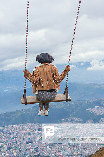 Young woman enjoying the largest swing in the world.