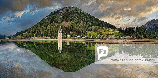 Kirchturm im Reschensee mit Spiegelung  Graun  Reschen  Trentino-Alto Adige  Italien  Europa