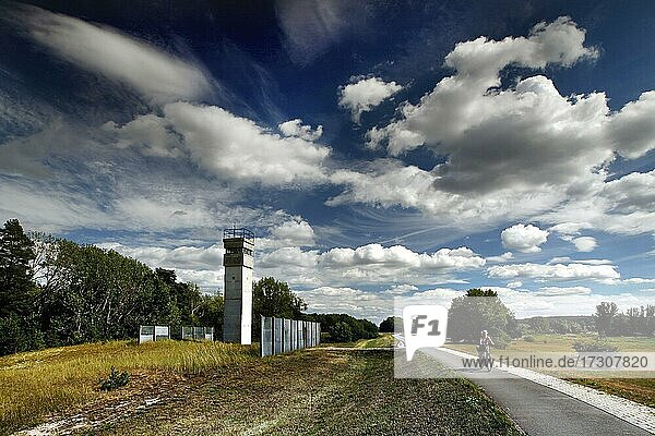Observation tower of the border troops of the GDR  border watchtower  border fence  expanded metal fence  border signal fence  barbed wire fence  cyclist  Elbe dike  Elbe cycle path  column path  perforated plate path  inner German border installation  Green Belt  border path  UNESCO-Bio