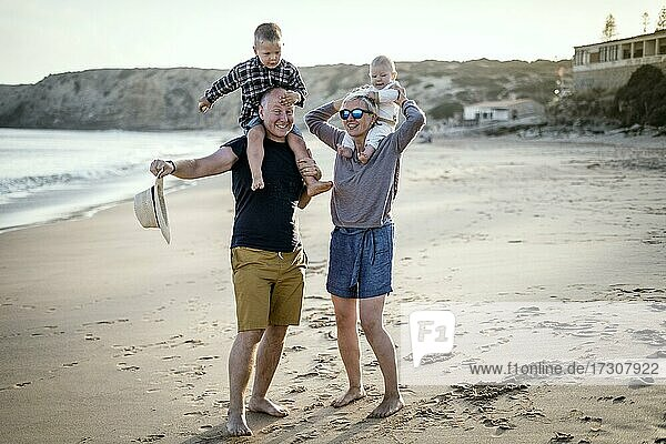 The family with two small boys enjoying the beach  Algarve  Portugal  Europe