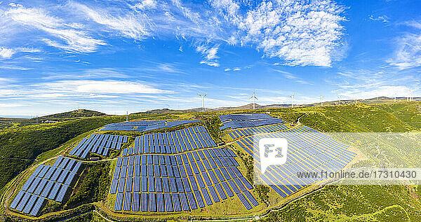 Solar panels and wind turbines on the green plateau  Encumeada  Madeira island  Portugal  Atlantic  Europe