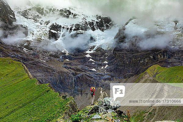 Two women trekking Humantay Lake  Cusco  Peru  South America