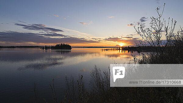 Colourful sunset in Spring at Astotin Lake  Elk Island National Park  Alberta  Canada  North America