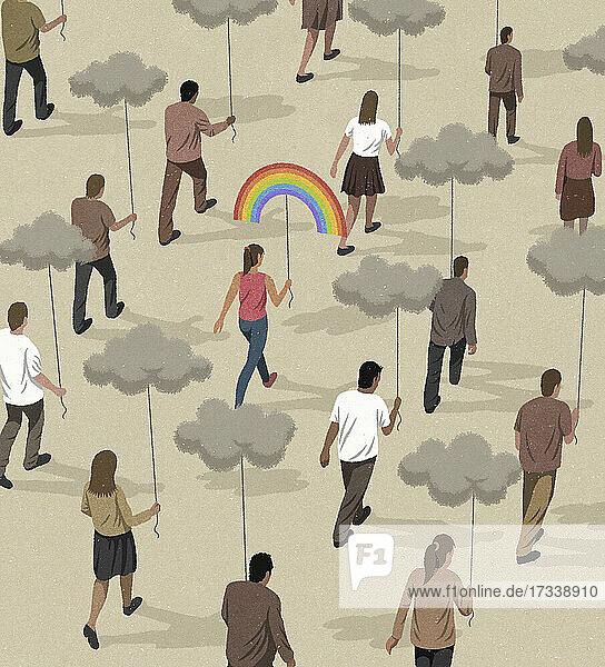 Frau mit Regenbogenballon hebt sich von anderen mit dunklen Wolken ab