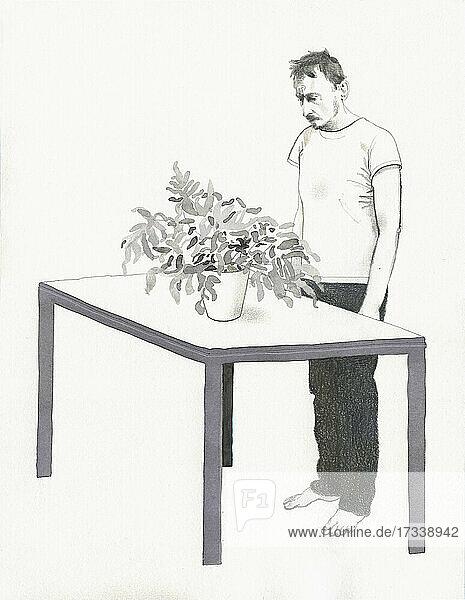 Besorgter Mann  der eine Zimmerpflanze untersucht
