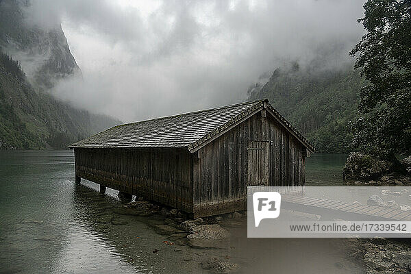 Germany  Bavaria  Pier with old wooden building on Obersee