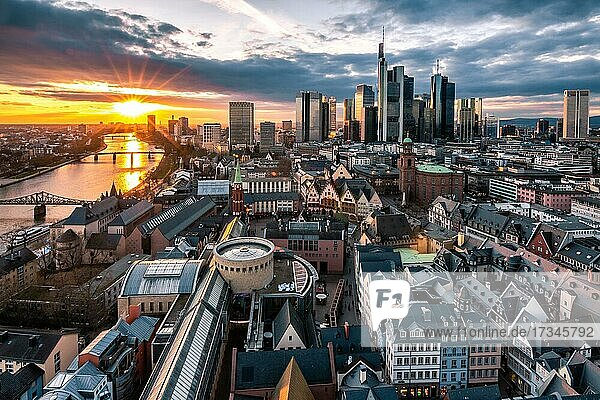 View into the sunset over an old town to the skyline  Frankfurt  Germany  Europe