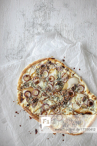 Pizza with pear  Gorgonzola  grapes and walnuts