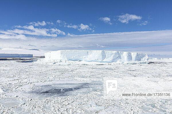 Iceberg amongst winter sea ice breaking up in the Weddell Sea  Antarctica  Polar Regions