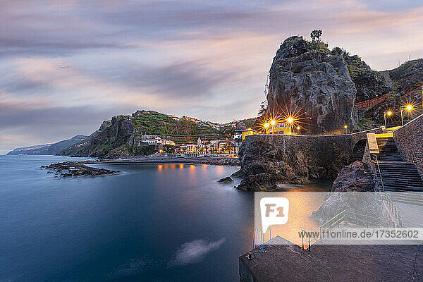 Dusk lights over the seaside town resort of Ponta do Sol washed by the ocean  Madeira island  Portugal  Atlantic  Europe