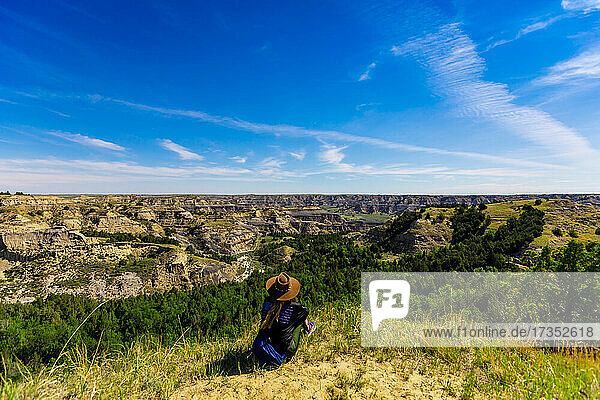 Woman enjoying the view along the Theodore Roosevelt National Park North Unit  North Dakota  United States of America  North America