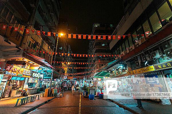 Hong Kong and China flag bunting hanging across street Hong Kong and China flag bunting hanging across street
