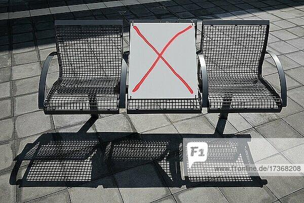 Corona distance rule on a bench in public space in spring 2021  Zentraler Omnibusbahnhof  Berlin  Germany  Europe Corona distance rule on a bench in public space in spring 2021, Zentraler Omnibusbahnhof, Berlin, Germany, Europe