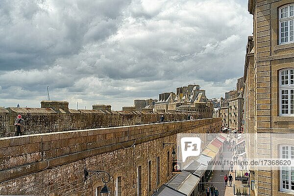 View from the city wall into an alley of the old town with colourful awnings of Saint Malo  Brittany  France  Europe