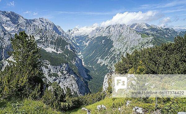 Hiker looking into the distance  view into the Reintal valley  in the background summit of the Zugspitze and Alpspitze with Zugspitzplatt  hiking trail to the Meilerhütte  Wetterstein Mountains  Garmisch Partenkirchen  Bavaria  Germany  Europe