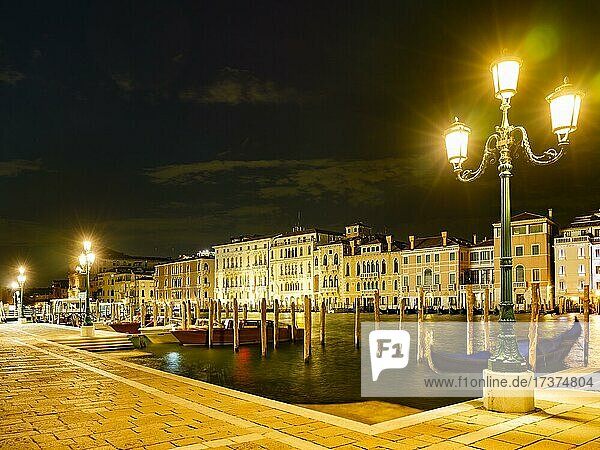 Boat mooring in front of historic house facade on the Grand Canal at night  Venice  Venezia  Veneto  Italy  Europe