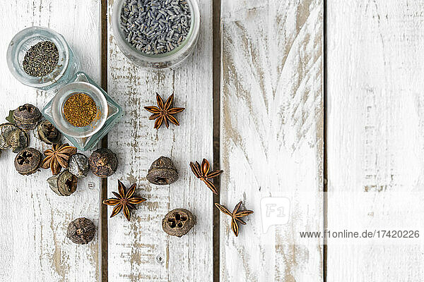 Spices and herbs arranged on wooden table